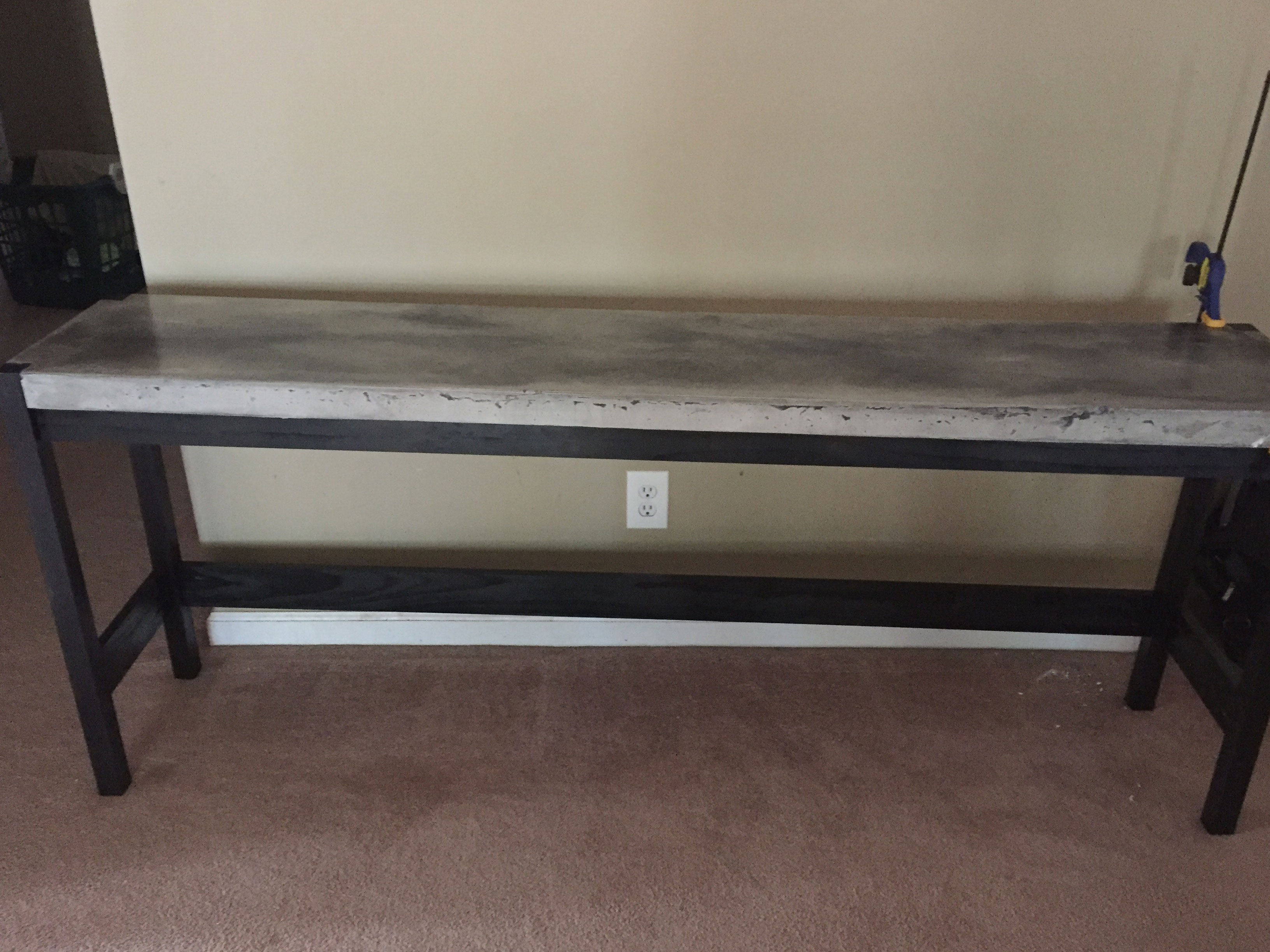 grey marbled stain concrete hallway table